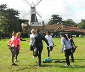 beginner runners stretching on the Common for website