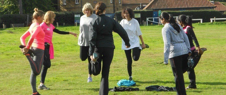 beginner runners stretching on the Common